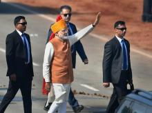 Prime Minister Narendra Modi waves at the crowd after attending the 70th Republic Day celebrations at Rajpath