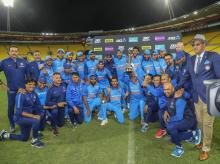 India's players celebrate with the series trophy after beating New Zealand their fifth one day international at Westpac Stadium in Wellington