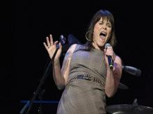 Beth Hart is pure kinesis, sinuous and twitchy, elegant and badass. She prays to the drums, kneels and sways before the guitar, hulks and roves above her keyboard, all flying hair  and tattoos