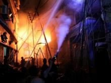 Firefighters work at the scene of a fire that broke out at a chemical warehouse in Dhaka | Photo: Reuters