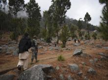 Pakistani reporters and troops visit the site of an Indian airstrike in Jaba, near Balakot, Pakistan