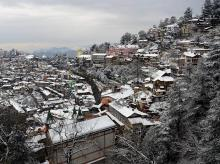 A view of the hill city of Shimla draped in snow after fresh snowfall