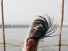 The photograph of a sadhu flipping his hair at the Sangam is a template shot