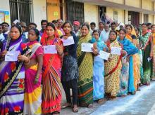Chhattisgarh elections Raipur- voters stand in a queue at a polling station to cast their votes for the 2nd phase of assembly elections. Photo: PTI