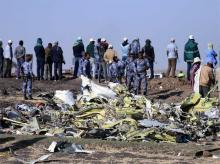 Ethiopian Federal policemen stand at the scene of the Ethiopian Airlines Flight ET 302 plane crash, near the town of Bishoftu, southeast of Addis Ababa, Ethiopia.