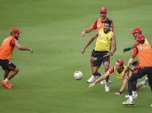 RCB skipper Virat Kohli with his teammates play soccer during a training session ahead of the IPL match between Sunrisers Hyderabad (SRH) and Royal Challengers Bangalore (RCB) at Rajiv Gandhi International Cricket Stadium in Hyderabad. File Photo: PT