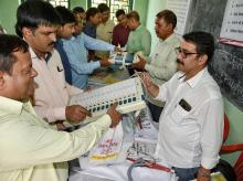 An electoral official demonstrates the functioning of an Electronic Voting Machine (EVM) and Voter-Verified Paper Audit Trail (VVPAT) during a training programme,in Patna