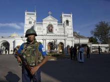FILE PHOTO | Sri Lankan air force officers and clergy stand outside St. Anthony's Shrine