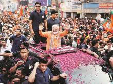 Prime Minister Narendra Modi, who is contesting the Lok Sabha election from Varanasi, during a roadshow in the city on Thursday. The constituency goes to the polls on May 19 Photo: Reuters