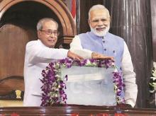Then president Pranab Mukherjee and Prime Minister Narendra Modi at the launch of the GST regime on July 1, 2017