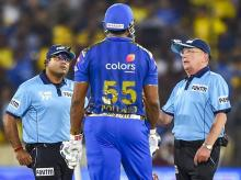 MI batsman Kieron Pollard speaks with umpires during the Indian Premier League 2019 final cricket match between Chennai Super Kings (CSK) and Mumbai Indians (MI) at Rajiv Gandhi International Cricket Stadium in Hyderabad. Photo: PTI