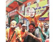 BJP supporters in Kolkata celebrate the party's lead in the Lok Sabha polls| Photo: PTI