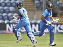 Cardiff:  India's captain Virat Kohli, left, and Rohit Sharma run between the wickets to score during the Cricket World Cup warm up match between Bangladesh and India at Sophia Gardens in Cardiff, England, Tuesday, May 28, 2019. (AP/PTI)