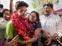 All India National Eligibility cum Entrance Test (NEET) topper Nalin Khandelwal celebrates with his parents after the declaration of results in Jaipur