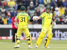 Australia's captain Aaron Finch, right is congratulated by teammate Australia's David Warner after getting 50 runs not out during the Cricket World Cup match between Australia and Pakistan at the County Ground in Taunton, south west England