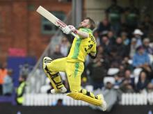 File photo: Australia's David Warner celebrates his century during the Cricket World Cup group stage match against Pakistan at the County Ground Taunton, England