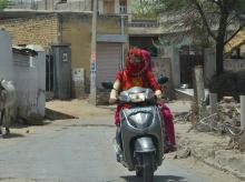 Instead of helmets, towels and scarves around the faces of two-wheeler drivers is a common sight