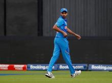 Bhuvneshwar Kumar leaves the field after getting his hamstring pulled. File photo: Reuters