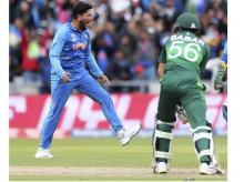 India's Kuldeep Yadav, left, celebrates the dismissal of Pakistan's Babar Azam, right, during the Cricket World Cup match between India and Pakistan at Old Trafford in Manchester, England, Sunday, June 16, 2019. AP/PTI Photo