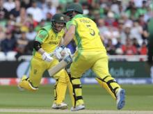 File photo: Australia's David Warner, left, and Australia's captain Aaron Finch run between wickets