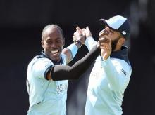 England's Jofra Archer, left, celebrates with a teammate the dismissal of Sri Lanka's captain Dimuth Karunaratne