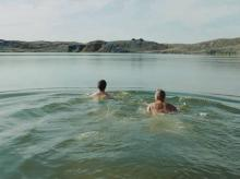 David Farrier, the host of television show Dark Tourist, swims in Kazakhstan's Atomic Lake