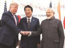 US President Donald Trump with Prime Minister Narendra Modi and Japanese Prime Minister Shinzo Abe during a trilateral meeting on the first day of the G20 summit in Osaka, Japan. Photo: Reuters