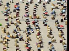 People enjoy bathing at a beach by the Baltic Sea in Travemuende, Germany, June 30, 2019
