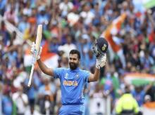 Birmingham: India's Rohit Sharma raises his bat and helmet to celebrate scoring a century during the Cricket World Cup match between Bangladesh and India at Edgbaston in Birmingham, England, Tuesday, July 2, 2019. AP/PTI