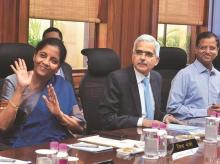 Nirmala Sitharaman with Shaktikanta Das and Finance Secretary Subhash Chandra Garg (right) in New Delhi on Monday | photo: sanjay k sharma
