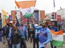 Indian supporters cheer for their team before the start of the Cricket World Cup semi-final match