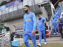 India's captain Virat Kohli leads his teammates to the field for the Cricket World Cup semi-final match