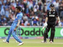 File photo: India's Yuzvendra Chahal, left, celebrates the dismissal of New Zealand's captain Kane Williamson, right, during the Cricket World Cup semi-final match between India and New Zealand at Old Trafford in Manchester, England, Tuesday, July 9