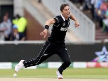 Zealand's Trent Boult celebrates the dismissal of India's captain Virat Kohli during the Cricket World Cup semi-final match