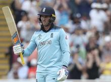England's Jason Roy raises his bat to celebrate scoring fifty runs during the Cricket World Cup semi-final match between England and Australia at Edgbaston. Photo: AP | PTI