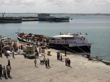 File Photo: Workers stand at the sea port of the coastal town of Kismayu in southern Somalia