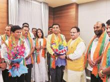 BJP Working President J P Nadda (third from right) with Goa CM Pramod Sawant (fourth from right) inducts rebel Congress MLAs