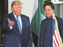 US President Donald Trump greets Pakistani PM Imran Khan as he arrives at the White House on Monday   photo:AP/PTI