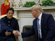 US President Donald Trump shakes hands with Pakistani PM Imran Khan during a meeting in the Oval Office of the White House,  in Washington. Photo: AP/PTI Photo
