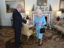 Britain's Queen Elizabeth II welcomes newly elected leader of the Conservative party Boris Johnson during an audience at Buckingham Palace | Photo: AP/PTI