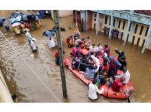 National Disaster Response Force (NDRF) conducts a rescue operation at a flooded area of Tambve village in Karad
