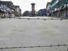 Srinagar: A view of a deserted street during restrictions at Lal Chowk in Srinagar, Wednesday, Aug 7, 2019. Restrictions have been imposed in several districts of Jammu and Kashmir as a precautionary measure after the state lost its special status an