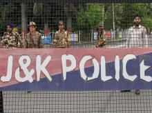Jammu: Security personnel stand guard during restrictions in Jammu, Friday, Aug 9, 2019. Restrictions have been imposed in several districts of Jammu and Kashmir as a precautionary measure after the state lost its special status and was bifurcated on