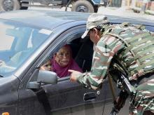 Srinagar: Security personnel stop a vehicle for checking during restrictions in Srinagar, Thursday, Aug 8, 2019. Restrictions have been imposed in several districts of Jammu and Kashmir as a precautionary measure after the state lost its special stat