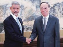 (Left) Foreign Minister Subrahmanyam Jaishankar with Chinese Vice President Wang Qishan at the Zhongnanhai leadership compound in Beijing on Monday. photo: Reuters