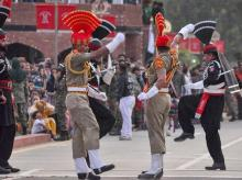 Attari: BSF and PAK Rangers during the Beating Retreat border ceremony on the occasion of 73rd Independence Day, at Attari-Wagah border post, about 35km from Amritsar, Thursday, Aug 15, 2018. (PTI Photo)