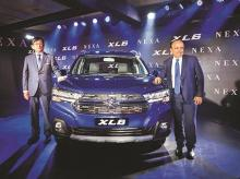 Maruti Suzuki MD & CEO Kenichi Ayukawa (left) and MSI Executive Director  (marketing and sales) Shashank Srivastava at the launch of Maruti Suzuki XL6,  in New Delhi on Wednesday | Photo: PTI