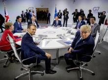 French President Emmanuel Macron, center left, and President Donald Trump, center right, participate in a G-7 Working Session on the Global Economy, Foreign Policy, and Security Affairs the G-7 summit in Biarritz, France, Sunday, Aug. 25, 2019. Also