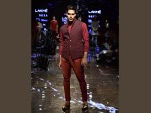 A textured bandi paired with fitted trousers from Kunal Rawal