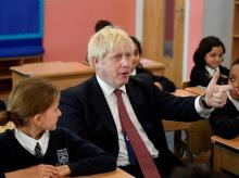 Britain's Prime Minister Boris Johnson attends a year six history class with pupils during a visit to Pimlico Primary school. Photo: Reuters